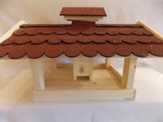 Vogelfutterstelle aus Holz mit Bitumendach und Futterkamin